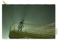Carry-all Pouch featuring the photograph Man On Stairs With Case In Fog by Lee Avison