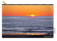 Carry-all Pouch featuring the photograph Marbled Godwits Reflecting A Sunset by Susan Wiedmann