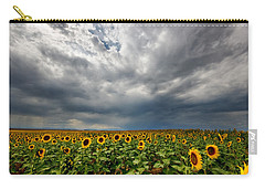 Carry-all Pouch featuring the photograph Moody Skies Over The Sunflower Fields by Ronda Kimbrow