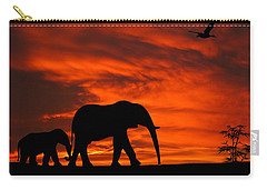 Mother And Baby Elephants Sunset Silhouette Series Carry-all Pouch by David Dehner