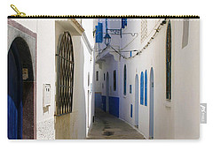 Carry-all Pouch featuring the photograph Narrow Backstreet In The Medina Of Asilah On Northwest Tip Of Atlantic Coast Of Morocco by Ralph A  Ledergerber-Photography