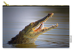 Nile Crocodile Swollowing Fish Carry-all Pouch by Johan Swanepoel