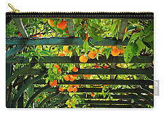 Carry-all Pouch featuring the photograph Oranges And Lemons On A Green Trellis by Brooke T Ryan