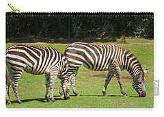 Carry-all Pouch featuring the photograph Pair Of Zebras by Charles Beeler