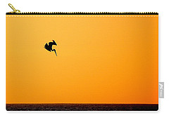 Carry-all Pouch featuring the photograph Pelican Diving At Sunset by AJ  Schibig