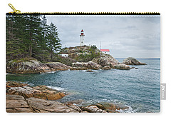 Carry-all Pouch featuring the photograph Point Atkinson Lighthouse And Rocky Shore by Jeff Goulden