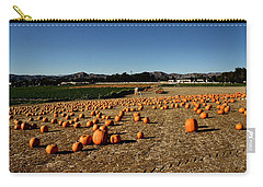 Carry-all Pouch featuring the photograph Pumpkin Field by Michael Gordon