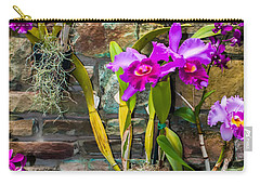 Carry-all Pouch featuring the photograph Purple Orchids With Cultured Stone Background by Alex Grichenko