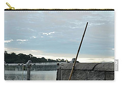 Carry-all Pouch featuring the photograph Rake Rests Itself After A Hard Days Work by Imran Ahmed