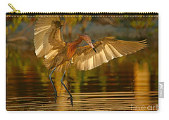 Reddish Egret In Golden Sunlight Carry-all Pouch by Myrna Bradshaw