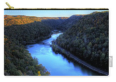 Carry-all Pouch featuring the photograph River Through A Valley by Jonny D