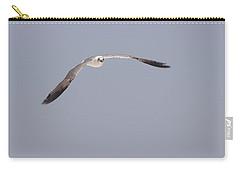 Carry-all Pouch featuring the photograph Seagull In Flight Against A Blue Sky by Charles Beeler