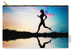 Silhouette Of Woman Running At Sunset Carry-all Pouch