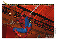 Spiderman Swinging Through The Air Carry-all Pouch by John Telfer