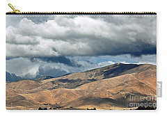 Storm Clouds Floating Above Mountains Carry-all Pouch by Susan Wiedmann