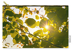 Carry-all Pouch featuring the photograph Sun Shining Through Leaves by Chevy Fleet