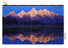 Carry-all Pouch featuring the photograph Sunrise Glow by Benjamin Yeager