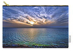 Carry-all Pouch featuring the photograph Sunset At The Cliff Beach by Ron Shoshani