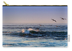 Carry-all Pouch featuring the photograph Sunset Fly by Kathy Bassett
