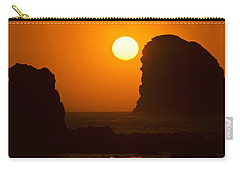 Carry-all Pouch featuring the photograph Sunset Over The Pacific Ocean With Rock Stacks by Jeff Goulden