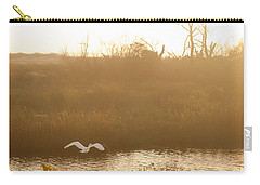 Carry-all Pouch featuring the photograph Taking Off Into A Golden Sunrise by Carol Lynn Coronios