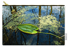 Carry-all Pouch featuring the photograph The Floating Leaf Of A Water Lily by Verana Stark