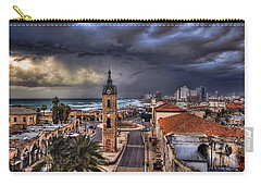 Carry-all Pouch featuring the photograph the Jaffa old clock tower by Ronsho
