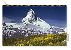 Carry-all Pouch featuring the photograph The Matterhorn With Alpine Meadow In Foreground by Jeff Goulden