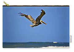 Carry-all Pouch featuring the photograph The Pelican And The Sea by DigiArt Diaries by Vicky B Fuller