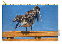 Carry-all Pouch featuring the photograph The Pelican by Hanny Heim