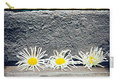 Carry-all Pouch featuring the photograph Three Daisies Stuck In A Door by Silvia Ganora