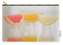 Three Fruit Juices In Bottles With Wedges Of Fresh Fruit Carry-all Pouch
