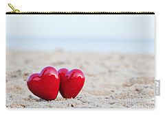 Two Red Hearts On The Beach Symbolizing Love Carry-all Pouch by Michal Bednarek