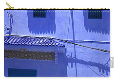 Carry-all Pouch featuring the photograph Typical Blue Facade In The Medina Of Asilah On Northwest Tip Of Atlantic Coast Of Morocco by Ralph A  Ledergerber-Photography