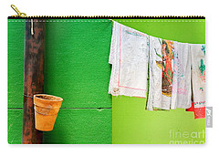 Carry-all Pouch featuring the photograph Vase Towels And Green Wall by Silvia Ganora