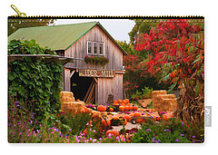 Carry-all Pouch featuring the photograph Vermont Pumpkins And Autumn Flowers by Jeff Folger