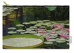 Carry-all Pouch featuring the photograph Water Lilies And Platters And Lotus Leaves by Byron Varvarigos