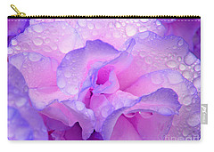 Carry-all Pouch featuring the photograph Wet Rose In Pink And Violet by Nareeta Martin