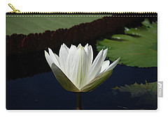 Carry-all Pouch featuring the photograph White Flower Growing Out Of Lily Pond by Jennifer Ancker