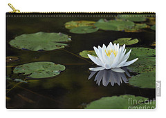Carry-all Pouch featuring the photograph White Lotus Lily Flower And Lily Pad by Glenn Gordon