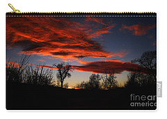 Carry-all Pouch featuring the photograph Wicked Skies by Janice Westerberg