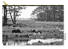 Wild Horses Of Assateague Feeding Carry-all Pouch by Dan Friend