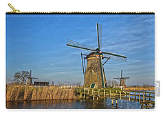 Carry-all Pouch featuring the photograph Windmills And Bridge Near Kinderdijk by Frans Blok