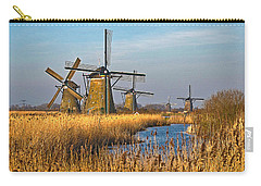 Carry-all Pouch featuring the photograph Windmills And Reeds Near Kinderdijk by Frans Blok