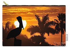 Carry-all Pouch featuring the photograph Pelican At Sunset by Dan Friend