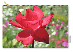 Carry-all Pouch featuring the photograph A Beautiful Red Flower Growing At Home by Ashish Agarwal
