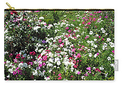 Carry-all Pouch featuring the photograph A Bed Of Beautiful Different Color Flowers by Ashish Agarwal