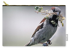 Carry-all Pouch featuring the photograph A Bird And A Twig by Elizabeth Winter