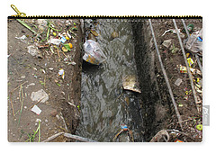 Carry-all Pouch featuring the photograph A Dirty Drain With Filth All Around It Representing A Health Risk by Ashish Agarwal