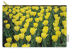 Carry-all Pouch featuring the digital art A Field Of Yellow Tulips In Spring by Eva Kaufman
